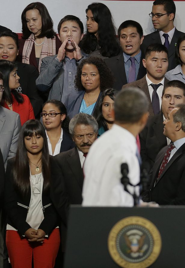 President Obama turns around to face reported 'heckler' Korean immigrant student Ju Hong.