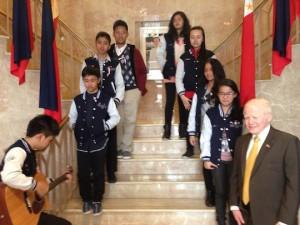 Students serenading Ambassador Jose Cuisia at the Philippine Embassy