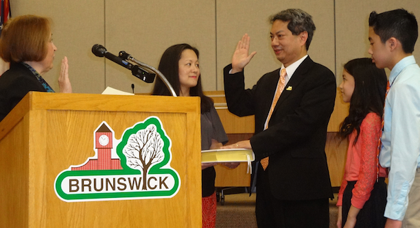 Taking his oath as the first FilAm mayor of Brunswick