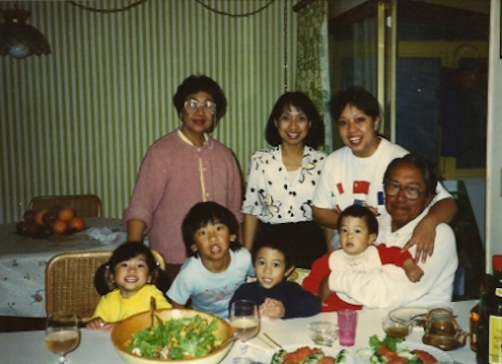 Jason being held by his grandfather, surrounded by family members in the San Francisco Bay Area, CA, 1989.
