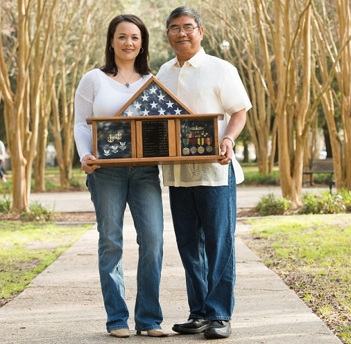 With her dad Marcial Felipe Lopez, a retired U.S. Navy officer: 'I grew up valuing a strong work ethic, respecting my elders, appreciating family togetherness'