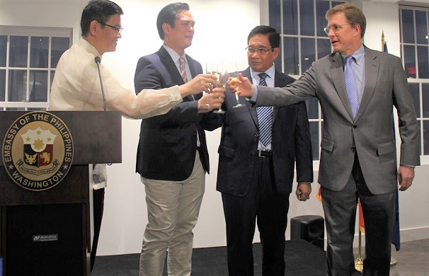 From left, Philippine Embassy Chargé d'Affaires ad interim Minister Patrick Chuasoto, Presidential Communications Secretary Jose Ruperto Martin Andanar, National Security Adviser Hermogenes Esperon, Jr.; and US Deputy Assistant Secretary of State W. Patrick Murphy offer a toast to the enduring ties between the Philippines and the United States at a reception marking the inauguration of Donald Trump, held at the Philippine Embassy Chancery on January 19.