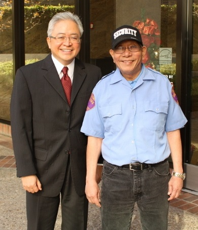 The author with client, security guard Ernesto Salamante