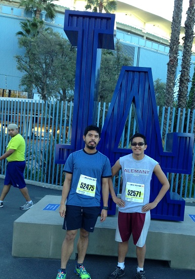 Lawrence (right) finishes top 10 of his age group (18-24) in  this Month's 5k run sponsored by L.A. Marathon. His cousin Jeremy Ochoa  ran with him.