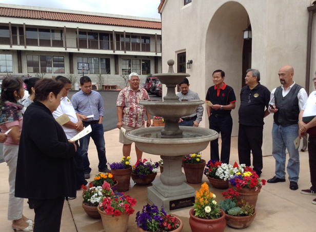 Pastor Alex Achacoso (in Hawaiian shirt) and UP Sigma Rho 'brods' gather around the Eternal Oneness Fountain they donated to the church. The FilAm L.A. Photos