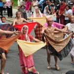 Filipinos perform a traditional dance at a cultural day parade. Photo by Elton Lugay