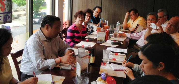 Lavarro with Jersey City's 'elders' during the May 31 Kapihan. Photo by Momar Visaya