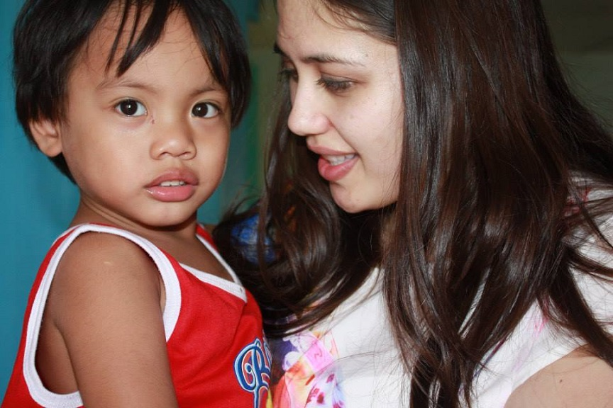 The author with a special needs child from Bahay ni San Jose Home for God's Special Children orphanage  in Tarlac City