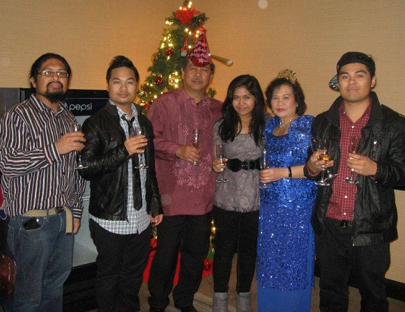 The Baradis at a New Year's party hosted by a FilAm organization. With Erman (second from left) are parents Rubin and Erna and siblings Erbin, Rena and Erson