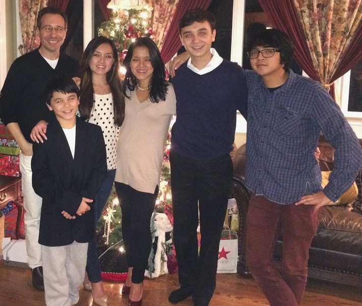 The author with husband Craig and their four children: 'With Obamacare, you  pay extra for every child!'
