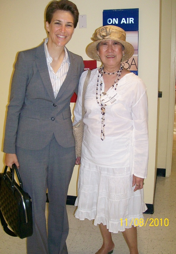 With Rachel Maddow. 'I told her my husband is a fan so she asked for my address and sent him an autographed picture'