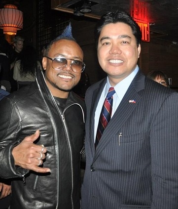 The author with Black Eyed Peas' apl.de.ap at a typhoon Haiyan fundraiser. Photo by Elton Lugay