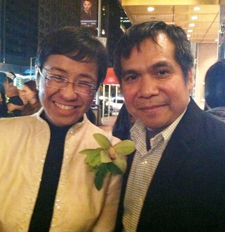 Maria Ressa and NYC teacher Ernie Pamolarco share a quick snapshot after the show.