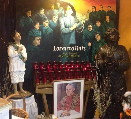 Two statues and a mural of San Lorenzo Ruiz