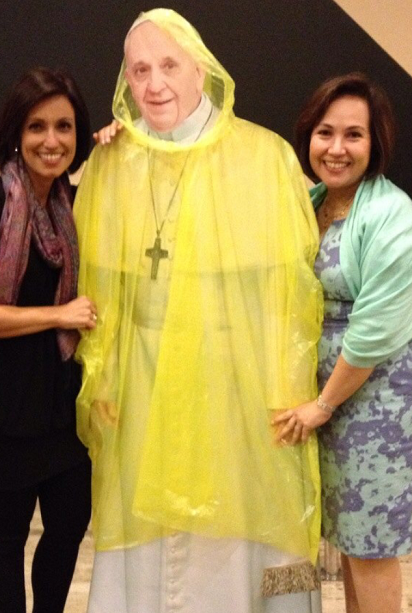 Marga Zaragoza Tolentino (right) and sister  Loudette Banzon pose with a cutout image of Pope Francis