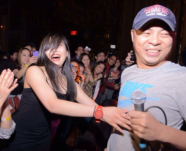 A fan attempts to get close to lead singer Chito Miranda.