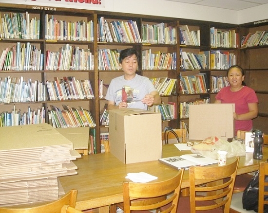 Top: All these books shipped to the Philippines came from NYC public schools. They found a new home at Samar's mini public libraries (lower photo).