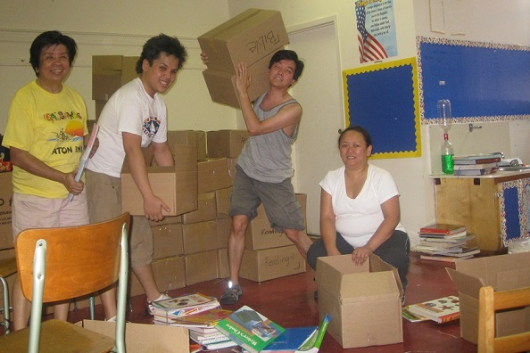 The author (left) supervising the packing of books