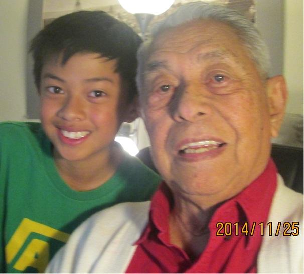 Author Tony Joaquin with grandson Julian: 'Never hurt girls.'