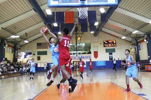 Leading scorer of the tournament, Jordan Bartlett, captured flying high against Team Panama.