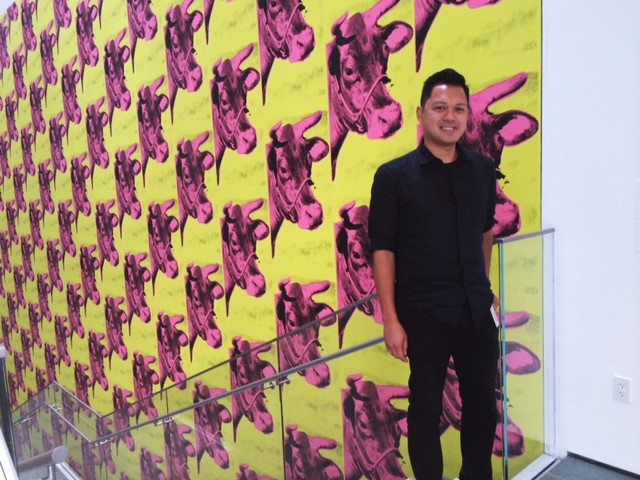 Francis before Andy Warhol's 'Cow Paper' mural at MoMA. The FilAm Photo