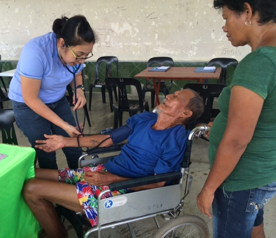 An elderly patient who has not seen a doctor in several years came to the medical mission. The FilAm Photos