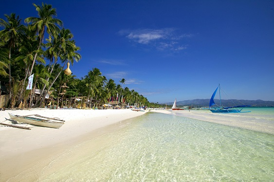 Boracay Island's powdery white sand and shallow azure water  are the main draw, say travelers.