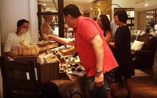 Myrna explains her products at a Pottery Barn pop-up.