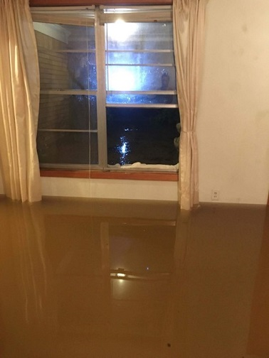 Flood water sitting in the house of Francis Navarro in Katy, the first city outside west of Houston. Navarro's parents were trapped for 10 hours but eventually rescued. He works as operational and sales Manager  at Hilton Garden Inn Hotel in Sugar Land.
