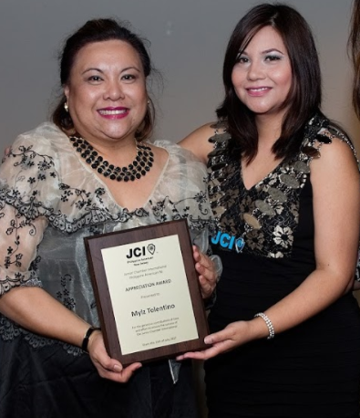 Chapter President Maricar Taino presents plaque of appreciation to Mylz Tolentino of Western Union.