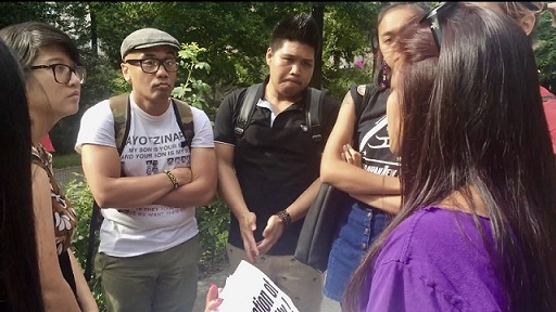 After nearly three hours of marching, the group of Filipinos stepped out of the chanting crowd in Central Park to discuss next steps. Photos by Mariel Padilla.
