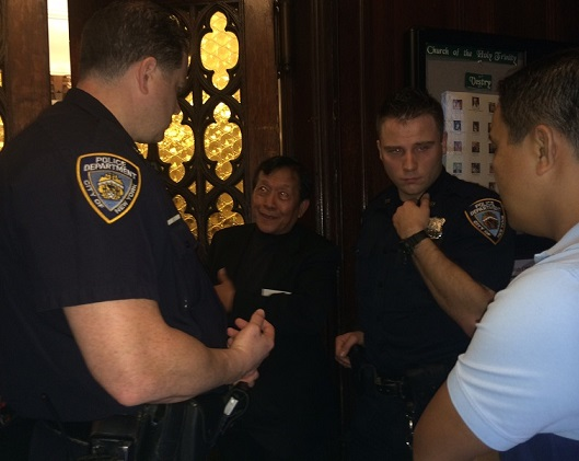 NYPD officers interview Ronie Mataquel about his removal from the polling floor carried by three security volunteers. The FilAm photos