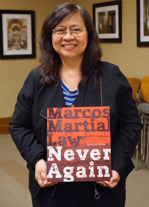Robles with her third book: 'Marcos is Duterte's idol and role model.'  Photos by Lambert Parong/FAPCNY