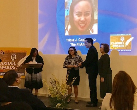 Tricia Capistrano receives her award for Best Personal Essay