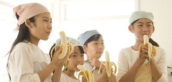 Japanese students enjoy their bananas. Photo: Getty Images