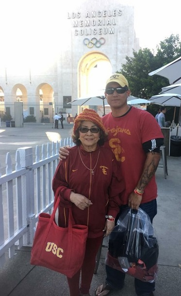 The author with her grandson Jason, her 'date' to the November 4 football game between  the University of Southern California and the University of Arizona. Ludy was a teacher at USC for three decades.