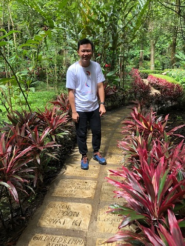 John Kenzi Leyno, education officer at the Philippine Eagle Center. The stone steps have the names of individuals who have made donations in support of the work of the center.