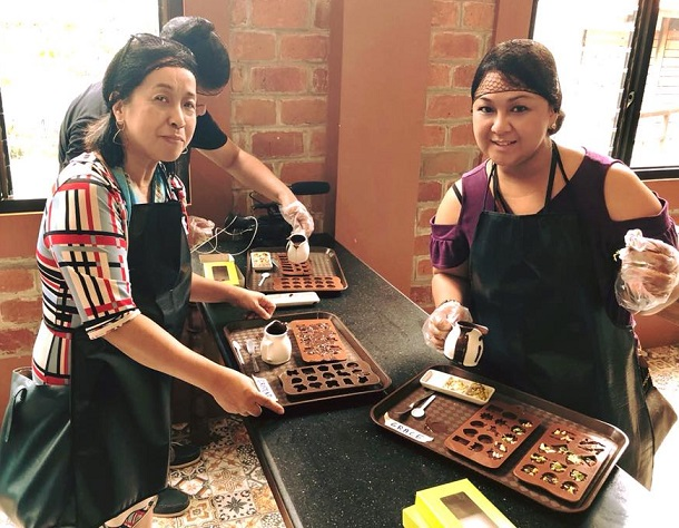Members of the FilAm media try their hand at chocolate making. Photo by Grace Labaguis