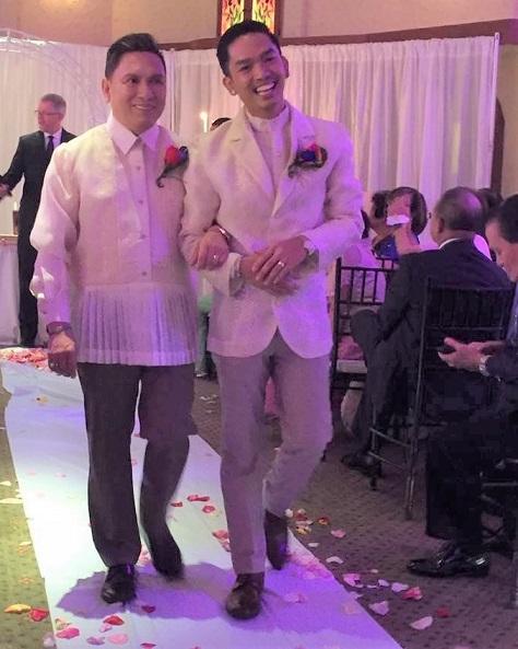 The couple wore white: Alex Esteban (left) and Rodrigo Pangesban tie the knot.