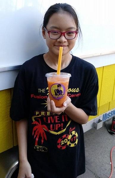 A young customer enjoying her Mr. Matcha Tea