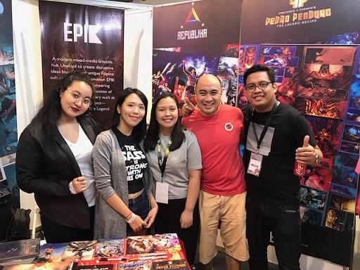 The author (in red shirt) with Epik Studios creatives. From left: writers Allison Aviado and  Regene Estolatan, graphic artist Dannie Santos, and senior artist Jerome Jagonia.