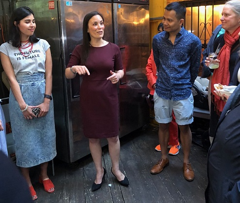 'We are being tested as Americans,' she tells supporters at a fundraising event in NYC. To her left is Aries Dela Cruz, Gov. Andrew Cuomo's Manhattan Regional Representative.  The FilAm Photo
