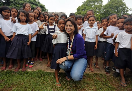 Vice President Leni Robredo visited Agutaya town in Palawan in 2016; she is shown here with the town's malnourished children. (Photo: Office of the Vice President)