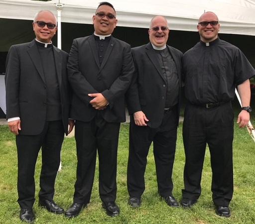 From left:  Msgr. Romualdo Sosing, the first Filipino parish priest in Long Island; Fr. Novio; Pastor Robert Quadrato; and seminarian Bob Carolan.