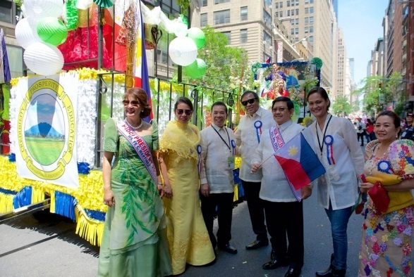 Four-term President Fe Martinez (far left) and former treasurer Violeta McGough, wearing a yellow terno with officers and supporters of PIDCI.