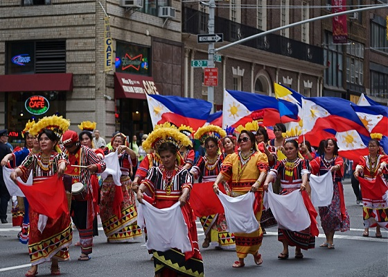 Philippine flags fly proudly during Independence Day parade.