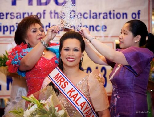 Mrs. Kalayaan 2013 Rose Labelle is crowned by Grand Marshal Dr. Dolly Rivera (left) and former Consul General Tess Dizon-De Vega.