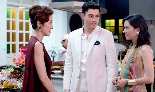 Wealthy Singapore matriarch Eleanor Young (played by Michelle Yeoh) gives a frosty reception to son Nick's girlfriend Rachel Chu (Constance Wu). Henry Golding portrays Nick.