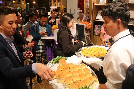 NaFFAA Executive Director Jason Tengco tries some adobo sliders served during the launch of 'The New Filipino Kitchen.'