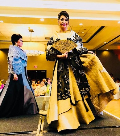Leonard's fashion show in New Jersey. Evelyn Sison in a stylized Maria Clara with a filigree fan to complete the look.